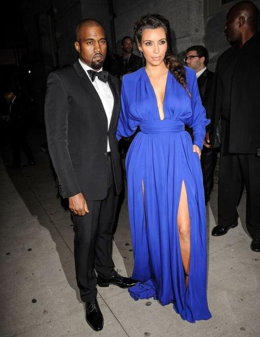 Blue suit black dress - Best Dressed